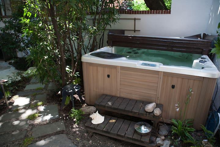 The hot tub nestled in the back corner