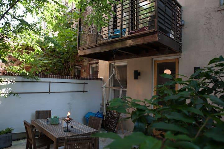 The 2nd floor balcony overlooks the backyard and lounge area.