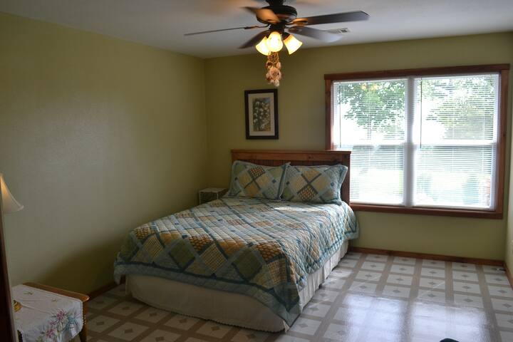 Spacious Master bedroom and comfortable chair to sit and relax.