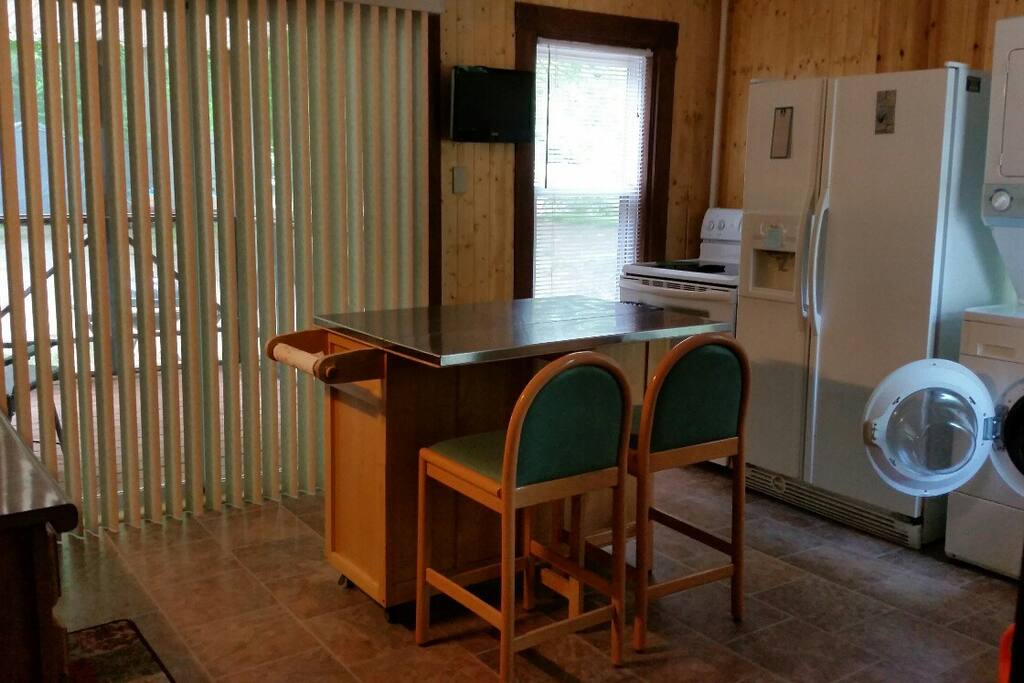 Kitchen area with washer/dryer, Keurig coffee maker, microwave, only missing your groceries!