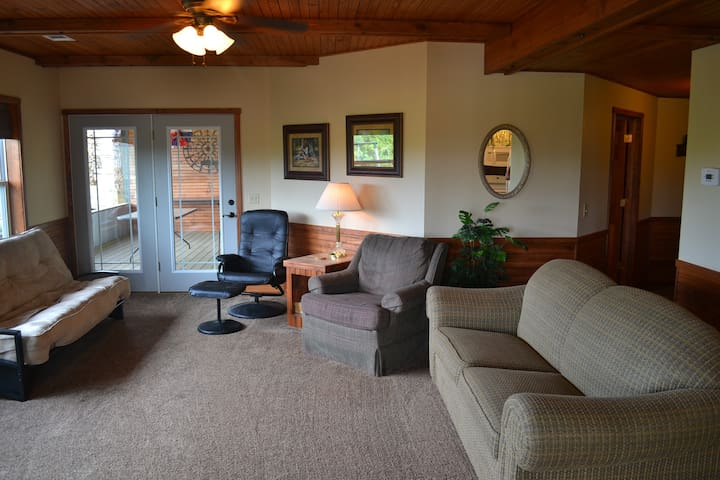 Spacious living space! Central heat and air. Sofa sleeper, chairs, and additional futon to accommodate several guests to enjoy visiting or watching a program on the Dish TV provided for your entertainment.