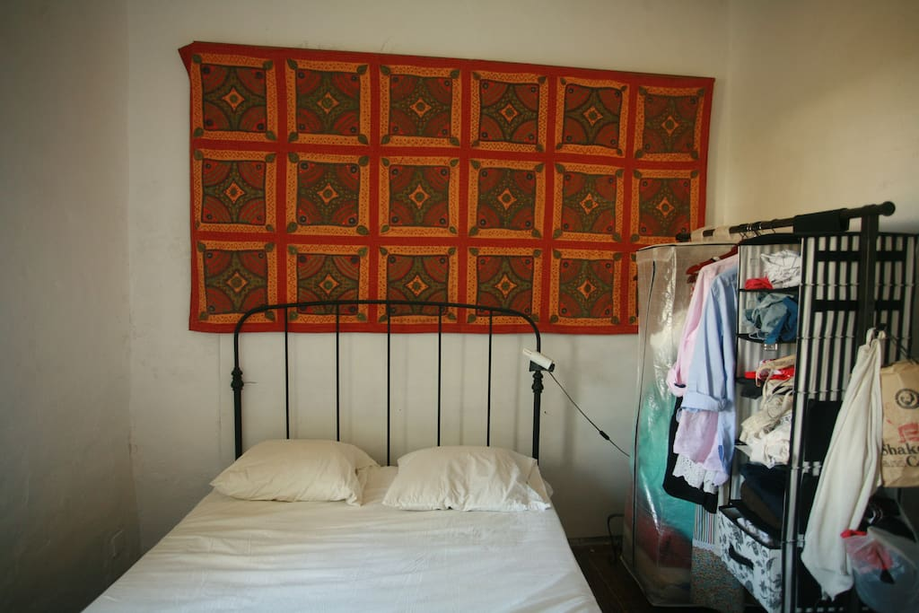 The main bedroom, sunny, simple and breezy in the summer, warm in the winter