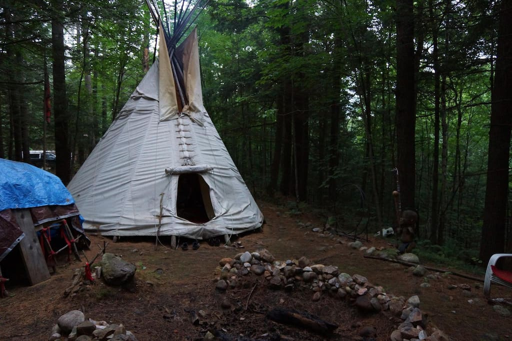 Tipi and sweat lodge from the fire pit