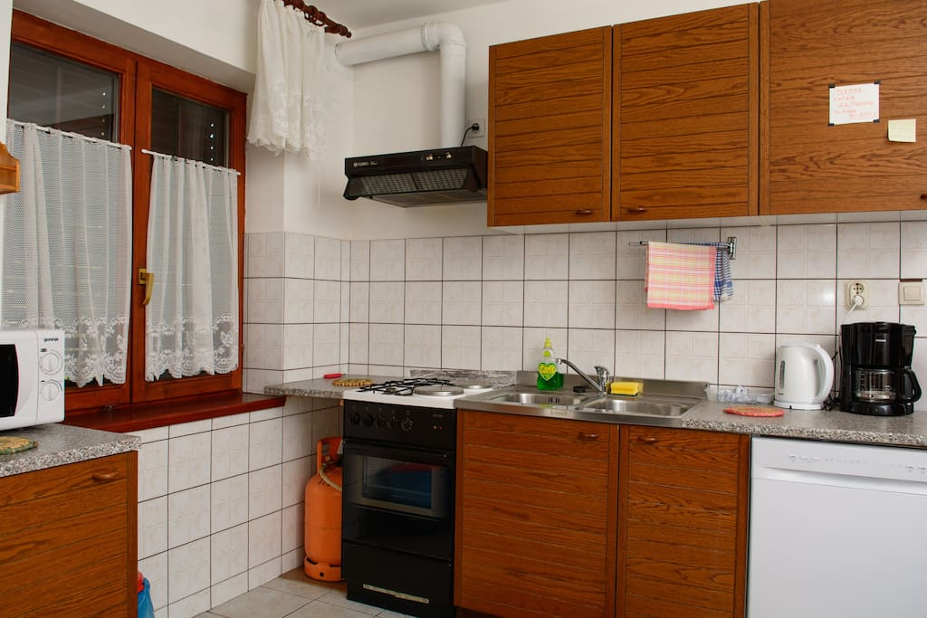 kitchen with coffee maker, microwave, dish washer and all dishes what u need.