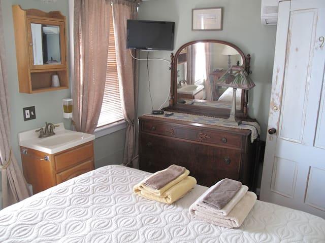 In room sink, air conditioner (behind door)