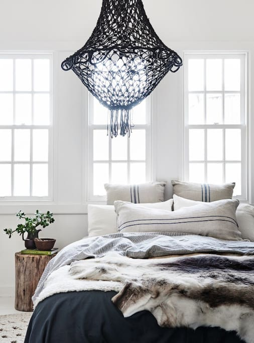 Divine large bright bedrooms with layers of beautiful throws and pure linen bedding.
