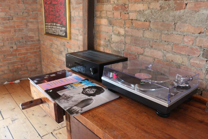 Turntable with modest vinyl collection.  Aux cable provided to plug phone/computer device into the receiver to listen to your personal collection.