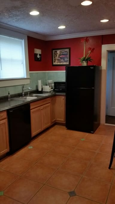 Kitchen with Stove,Oven, Microwave, Refrigerator, Sink, Tile Floors