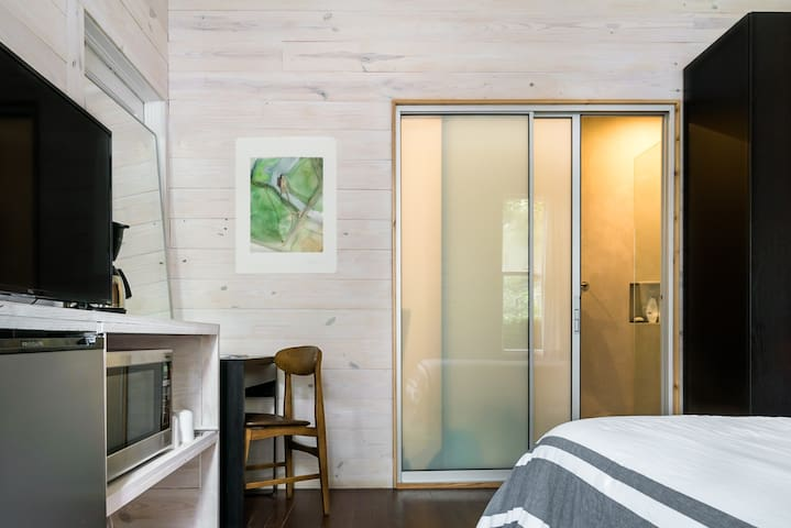 Translucent sliding doors allow natural light into the bathroom while providing privacy.