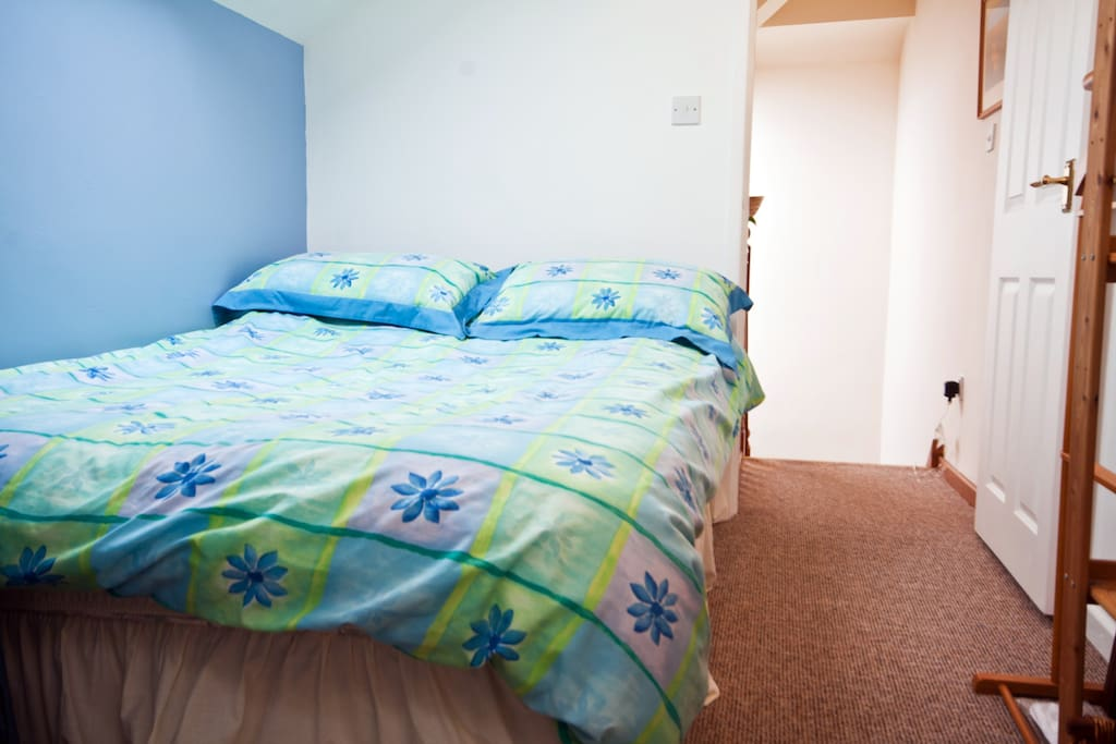 Newly decorated double room with private staircase.