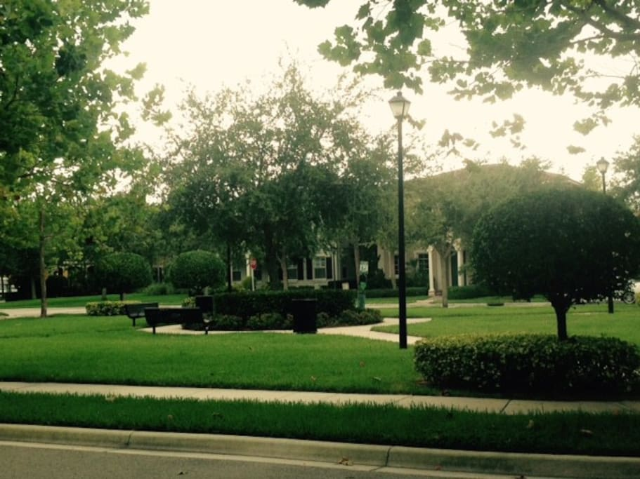 Green space in front of home.  Kids can play here, adults can enjoy a beverage.