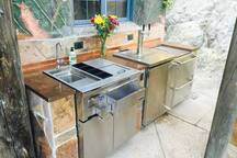 Outdoor Beverage station with 2 Lynx refrigerators and dual keg tap