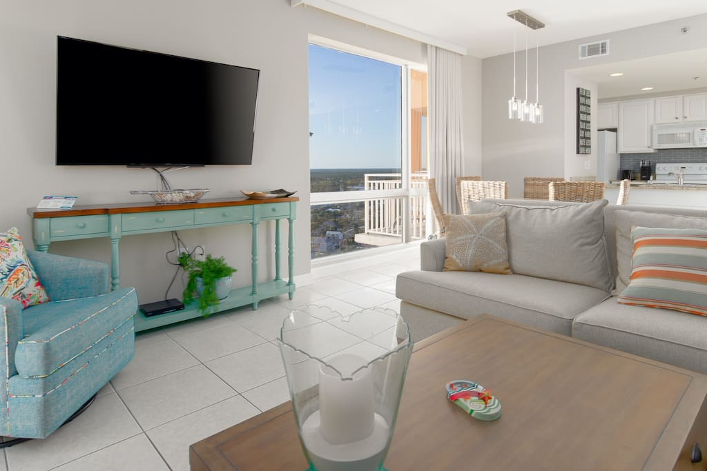 Open and bright, this beachfront condo is perfect for entertaining