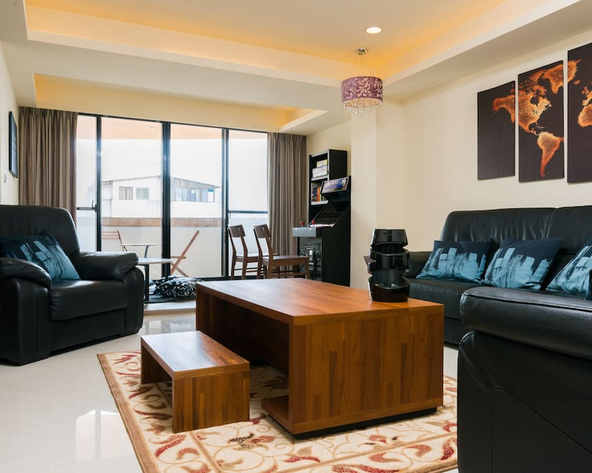 """Enjoy This Fabulous Living Room w/ Leather Couches, 58"""" TV, Attached Rec Room, Attached Balcony & Attached Dining Room"""
