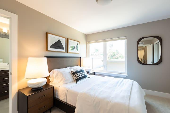 Bedroom with queen-size memory foam mattress.