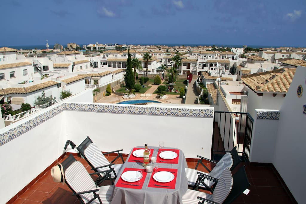 The sea view from the rooftop terrace overlooking the pool and the garden area.