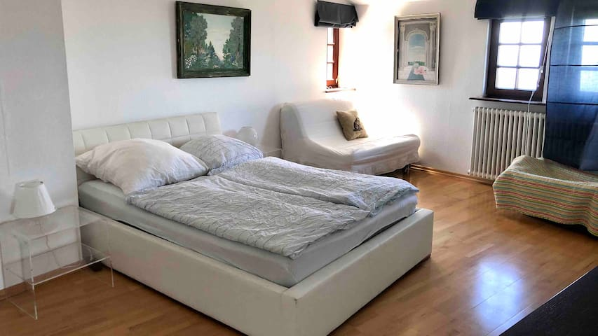 Master bedroom with 140 cm bed and 140 cm bed couch