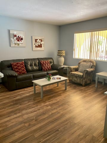 Bright and roomy family room with cable TV  Couch makes into a bed, sleeps 2