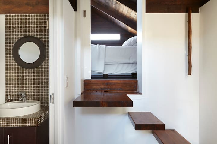 The fourth bedroom is a twin loft room that offers a cozy hideaway with skylight for starry nights