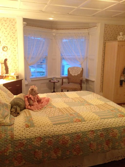Room 1, The Seaview Room, overlooking the harbour with a queen bed and ensuite washroom.