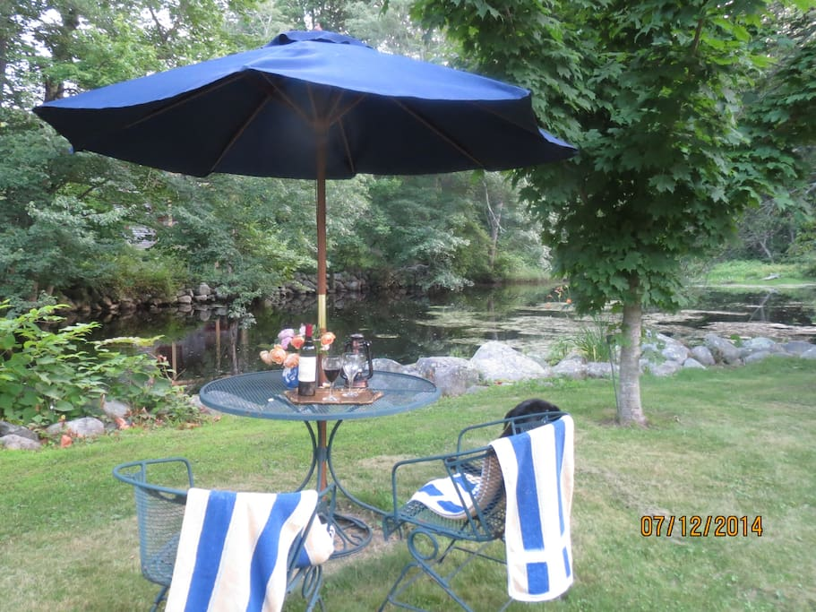 Overlooking a one acre pond, enjoy a relaxing morning coffee or evening beverage