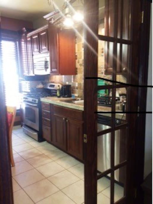 kitchen with all stain steel appliance including microwave, dishwasher, and full size washer and dryer.