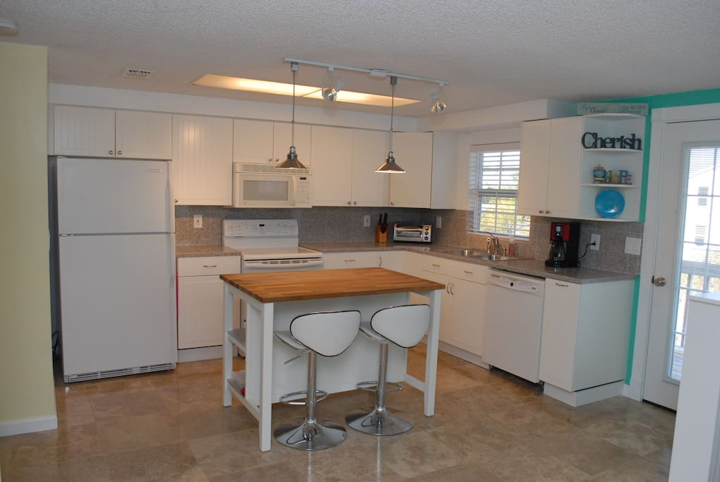 Luxury Kitchen with Granite Counters and Everything You Need to Make Your Own Gourmet Meals