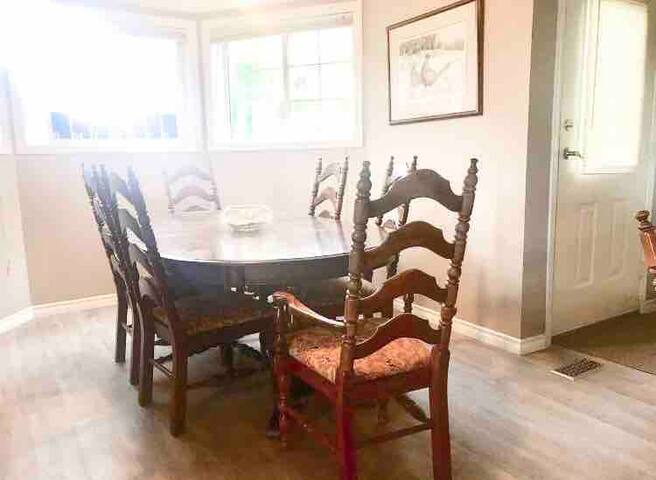 Dining room seats 6.  Additional games room table seats 4.