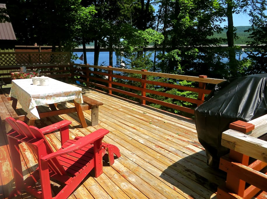 Large Deck with Full view of Lake for Dinning and Sun Bathing with Retractable awning. Plus gas grill for barbecuing.