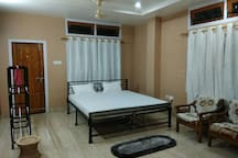 Master Bedroom 1: King Size bed with attached Bathroom and Balcony. Room Size: 235 Sqft.