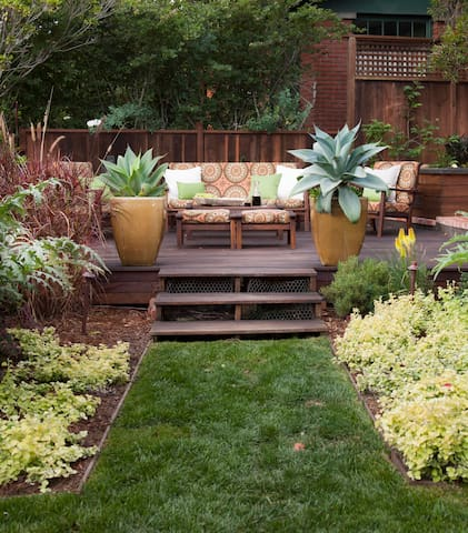 Enter through our award-winning garden to the outdoor deck which we encourage you to use.