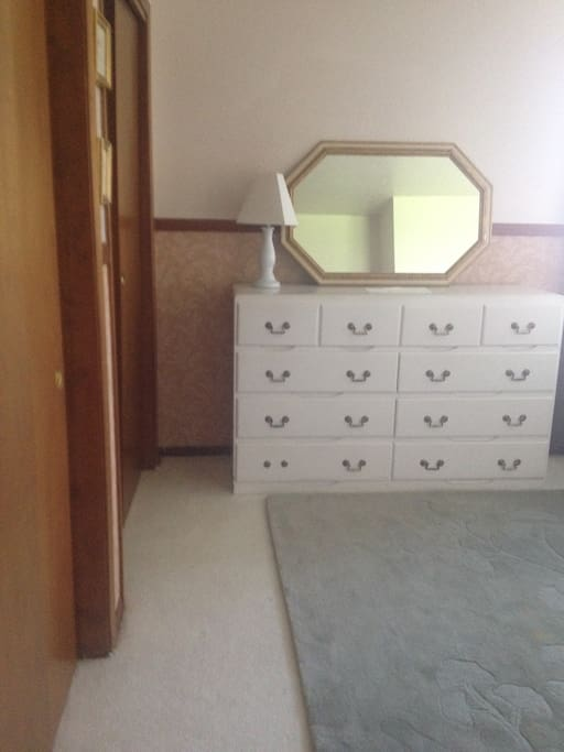 dresser, desk and nightstand with full closet