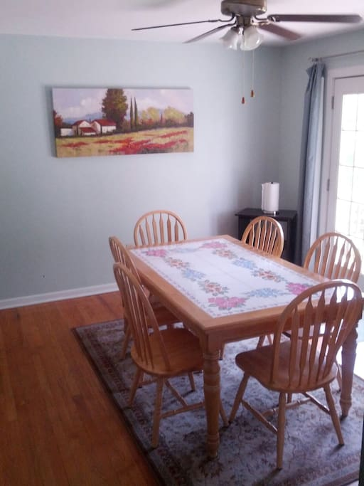 Dining room opens to deck with outdoor table and chair set, including, outdoor gas grill available for cooking.