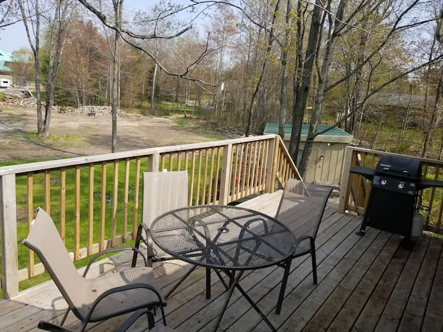 Deck off dining area with patio furniture and grill