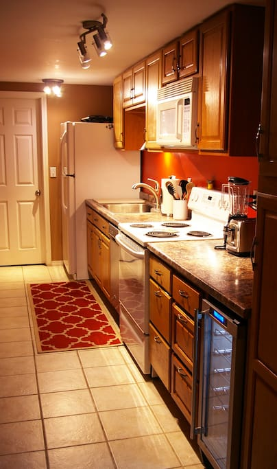 Galley kitchen with a built in wine cooler.