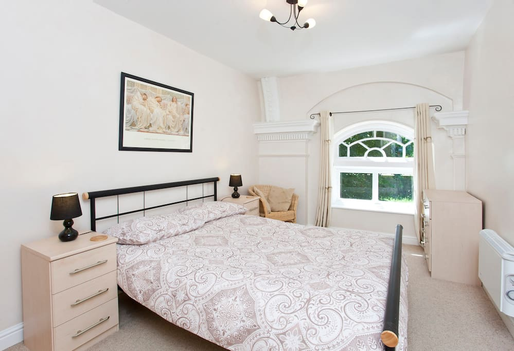 Bedroom with feature window