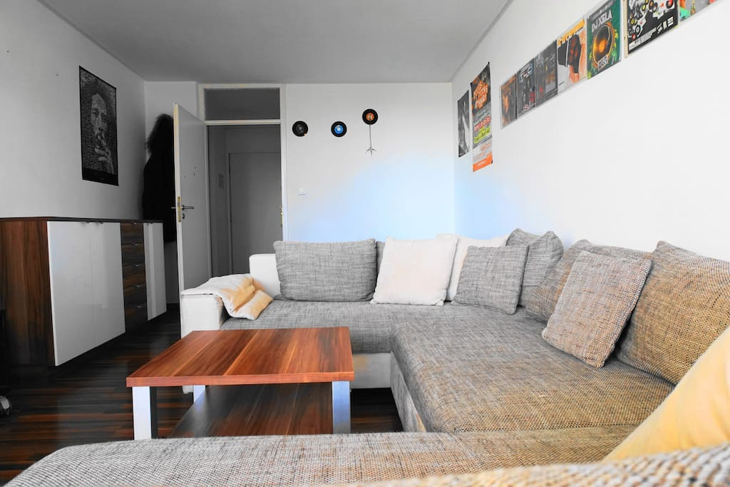 Comfy couch in the bright living room is perfect for a quiet moment after a busy day in Munich.
