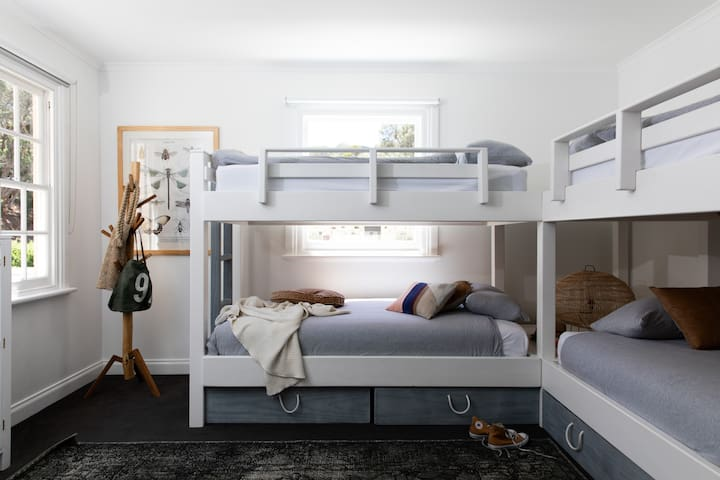 Our Frankie Bunk Beds are made from sustainably grown eco pine from House of Orange. Each bunk room has 4 beds plus a trundle that tucks away underneath enabling 5 to sleep easily in each bunk room.