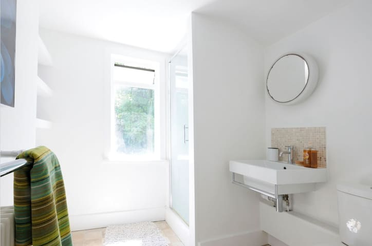 Private bathroom with toilet and shower overlooks garden