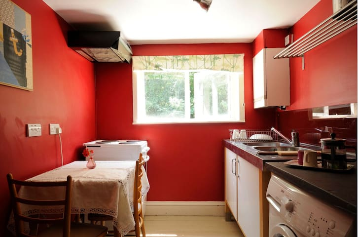 Private kitchen with cooker, fridge, washing machine and views over garden