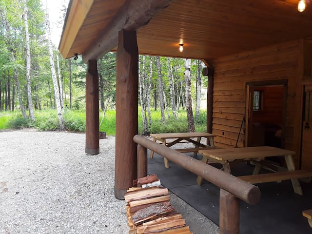 Includes firewood and 2 picnic tables