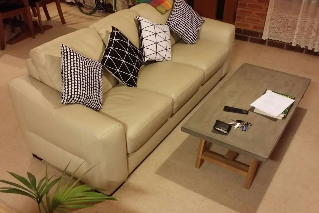 White Leather Couch with accompanying Concrete Coffee Table