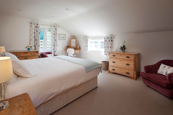 Master Bedroom with Super Kind bed, double aspect windows, storage space and armchair