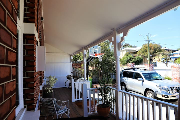 Veranda and secure parking for 2 cars