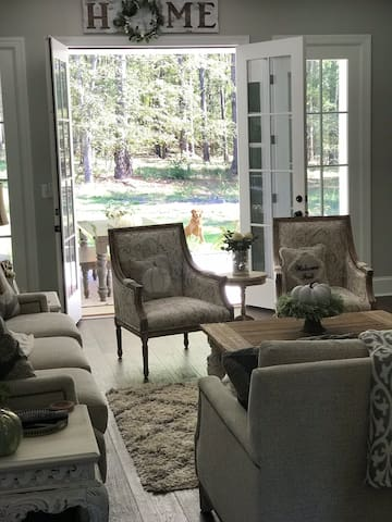 Living room opens to back porch