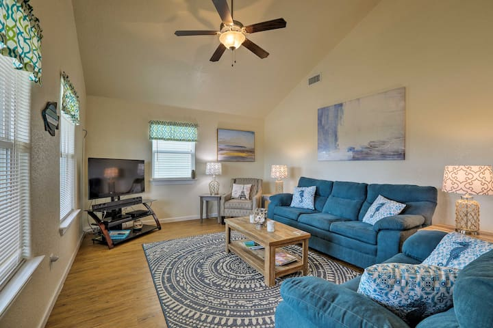 The living room is equipped with 2 plush couches and a flat-screen cable TV.