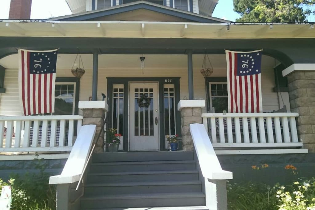 Front porch welcomes you with rockers and a swing.
