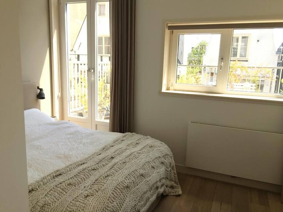 bedroom with door to terrace
