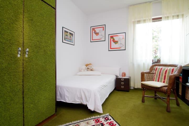 Your cozy green bedroom :)