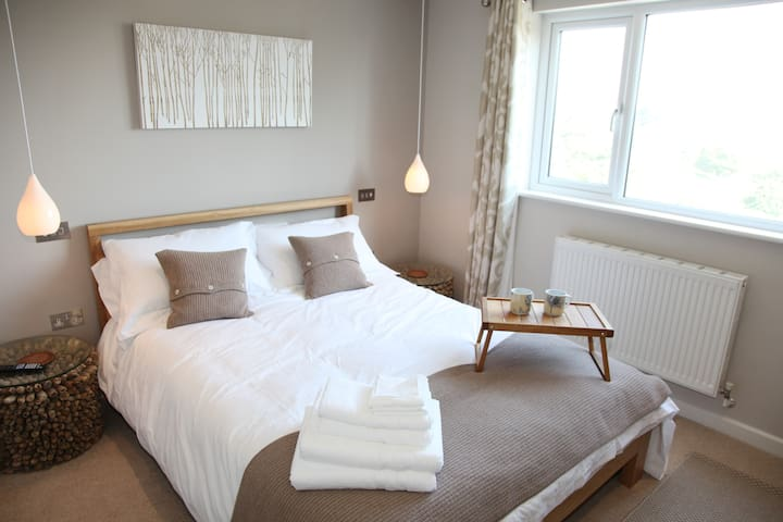 The Brown Bedroom -cool and funky with driftwood furniture. Also has an ensuite bathroom